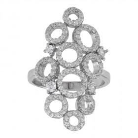 Åben ring i sølv med zirkoner på begge sider fra Joanli Nor